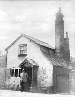 Joseph Arch as an old man outside his cottage