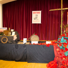 Central display: hand sewn poppies with a rustic cross | Alan McDermott