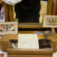 A wife's dressing table with original, silk, handmade postcards and a letter bearing bad news | Alan McDermott