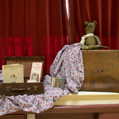 WW1 toys including a hand-knitted teddy bear.